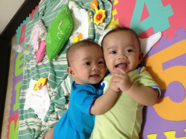that rare photo where they're both smiling. the twins at 6 months